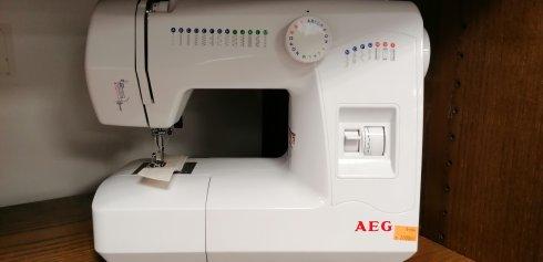 repasovaný šicí stroj AEG NM 220/25prog. + kufr zdarma